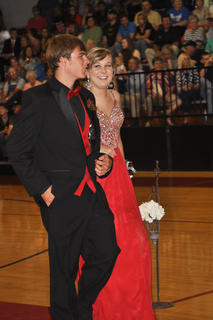 Dressed in matching shades of red, Amber Bloyd and Jordan Abel walk down the TCHS prom runway.
