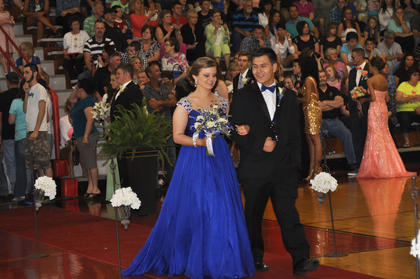 TCHS student Anthony Gonzalez glances toward his date Breanna Thompson as they walk down the prom runway.
