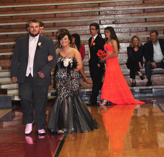 Dalton Blair and Allena Cox wait their turn to walk down the TCHS prom runway with Mark Grenke and Katelynn Williams close behind.