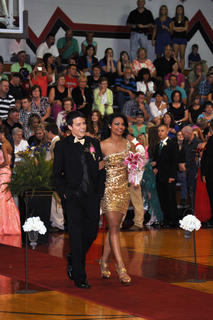 TCHS students Makenzie Hughes and Mason South match in sparkling gold during prom walk-in.