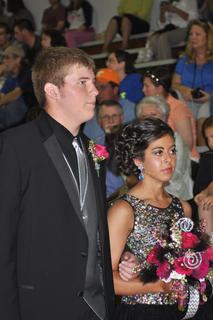 Dressed in black and silver, John Chewning and Haley Wright prepare to walk down the TCHS prom runway.
