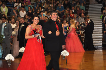 Hilary Suratt smiles for the camera as she and Slade Burriss walk down the TCHS prom runway.