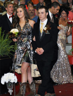 Joe Gill and Alex Zimmerman wear formal hunting gear during TCHS prom walk-in.