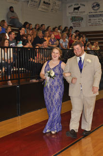 Brookylan Cox and Christopher Wilson laugh while waiting their turn to walk down the TCHS prom runway.