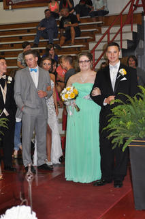 Michala Caulk and Cooper Wise step onto the runway during TCHS prom walk-in.