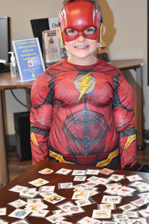 Nolan Reynolds, 7, stopped by to get some candy and a tattoo at the Taylor County Public Library Tuesday.