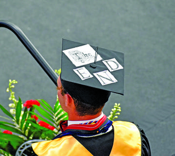 A graduate's cap reads 'the end' at Friday's ceremony.