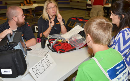 Campbellsville/Taylor County EMS personnel Brandon Porter and Candice Staton explain what will happen to a CHS student as he is being treated after committing a crime.