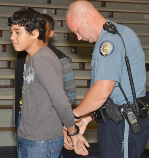 Campbellsville Police Officer Andy Warren arrests CHS students after they brought drugs to school.