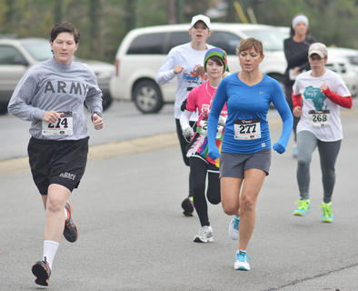 Runners hit their stride in Saturday's race. In front are Kristan Beard, at left, and Ione Ford.