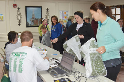 Runners register for Saturday's race.