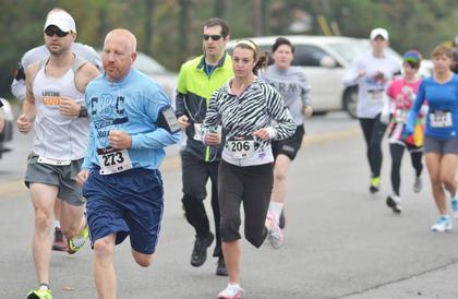 Runners Chris Ambers, at left, and Ellie McKinley set their pace for the race.