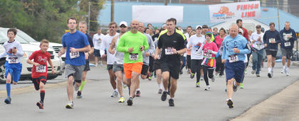 A group of runners gets a head start at the beginning of Saturday's race.