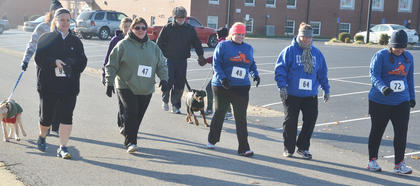From left, Gail Wise, Carrie Gaddis, Lindsay Hammers, Natalie Parker and Robbilyn Speer start the race.