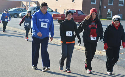 From left, Dr. Jimmy Ewing, Stephany Bowen, Abbey Fryrear and Nancy McLean Dix walk at the start of the race.