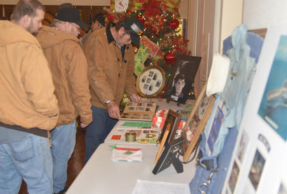 Veterans look at memorabilia from the Vietnam War that was on display at the Campbellsville Civic Center.