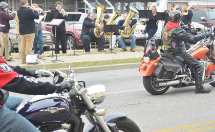 Taylor County High School band members play music as Patriot Guard riders pass.
