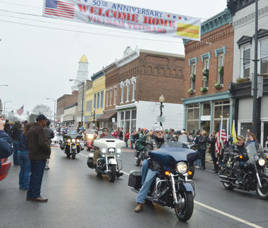Patriot Guard riders make their way down Main Street.