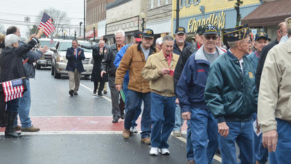 Vietnam veterans walk in the parade in their honor.
