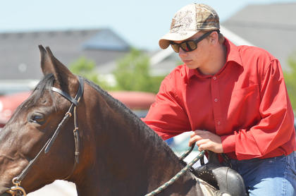 Garrett Haggerty of Campbellsville rides his horse in the youth horse show at the fair on Saturday.