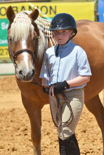 Gwendolyn Gadberry of Campbellsville stands as her horse Melody is judge in the youth horse show at the fair on Saturday.