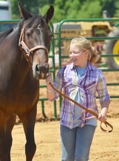 Breanna Sharp of Campbellsville leads her horse Candy as she participates in the youth horse show at the fair on Saturday.