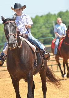 Dalton Reynolds of Campbellsville participates in the youth horse show at the fair on Saturday.